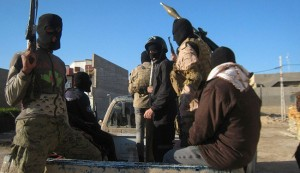 Masked ISIL gunmen patrol Fallujah, Feb. 8, 2014.