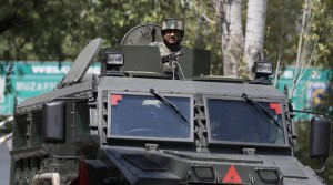 Uri: An army soldier guards the army base which was attacked by suspected rebels in Uri, in Jammu and Kashmir on Sunday. PTI Photo (PTI9_18_2016_000202B)