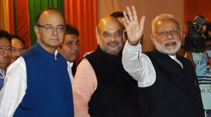 New Delhi : Prime Minister Narendra Modi with BJP President Amit Shah and Union Finance Minister Arun Jaitley during the Diwali Mangal Milan programme at BJP headquarters in New Delhi on Thursday. PTI Photo by Manvender Vashist(PTI11_3_2016_000327B)