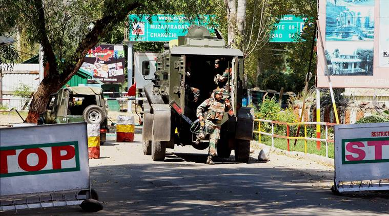 Uri: Army personnel in action inside the Army Brigade camp during a terror attack in Uri, Jammu and Kashmir on Sunday. PTI Photo (PTI9_18_2016_000084B)