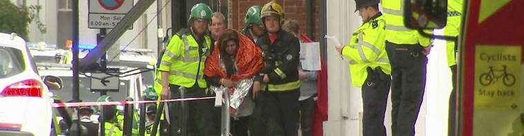 London: In this image made from video, a woman with blankets wrapped around her is being escorted  by emergency services near the scene of an explosion in London Friday, Sept. 15, 2017. A reported explosion at a train station sent commuters stampeding in panic, injuring several people at the height of London's morning rush hour, and police said they were investigating it as a terrorist attack. AP/PTI(AP9_15_2017_000140A)
